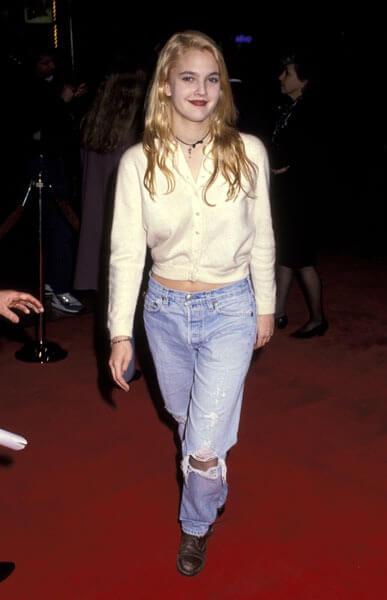 Dres Barrymore 90's denim jeans | WireImage/ Ron Galella