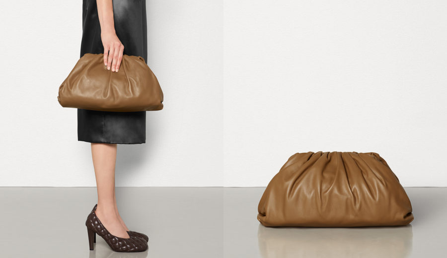 The iconic Botttega Veneta pouch in soft calfskin leather in Camello color